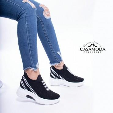 Sneakers con strass e rialzo