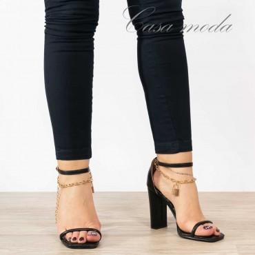 Sandali neri tacco catena oro